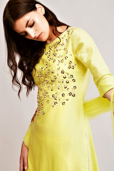 Buy pale yellow chanderi pearl work kurta with sharara online in USA. You can find a fine collection of Indian designer dresses in USA at Pure Elegance clothing store. Our range of traditional Indian clothing, designer silk saris, designer suits,  at our online store is sure to leave you awestruck. -kurta