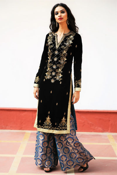 Buy black silk velvet embroidered Afghani inspired kurta with palazzo online in USA. Get occasion ready with a stunning range of Indian designer suits from Pure Elegance fashion store in USA. We bring the best designer dresses for Indian women in USA at our online store. Shop now-full view