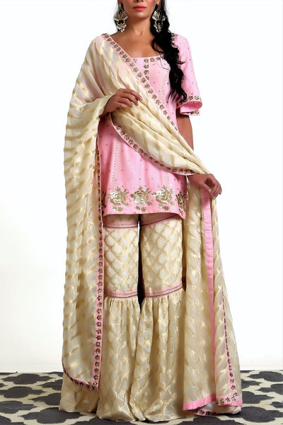 Buy blush pink short kurta with ivory tissue net garara and dupatta online in USA. Get occasion ready with a stunning range of Indian designer suits from Pure Elegance fashion store in USA. We bring the best designer dresses for Indian women in USA at our online store. Shop now.-full view
