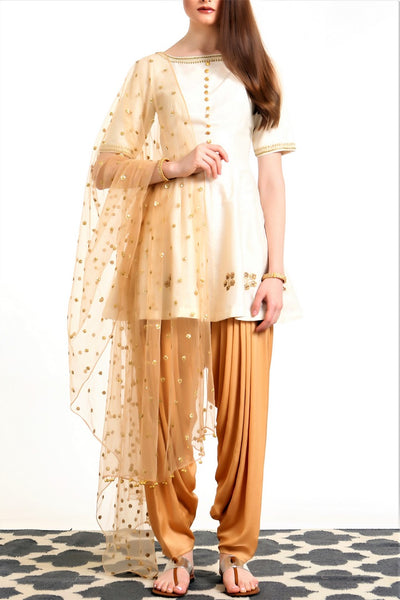 Buy ivory peplum silk blend kurta with gold dhoti salwar and dupatta online in USA. Get occasion ready with a stunning range of Indian designer suits from Pure Elegance fashion store in USA. We bring the best designer dresses for Indian women in USA at our online store. Shop now.-full view
