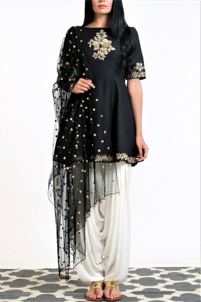 Buy black peplum silk blend kurta with white dhoti salwar and net dupatta online in USA. Get occasion ready with a stunning range of Indian designer suits from Pure Elegance fashion store in USA. We bring the best designer dresses for Indian women in USA at our online store. Shop now.-full view
