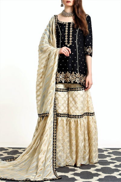 Buy black silk blend short kurta with ivory tissue net gharara online in USA. Get occasion ready with a stunning range of Indian designer suits from Pure Elegance fashion store in USA. We bring the best designer dresses for Indian women in USA at our online store. Shop now.-full view