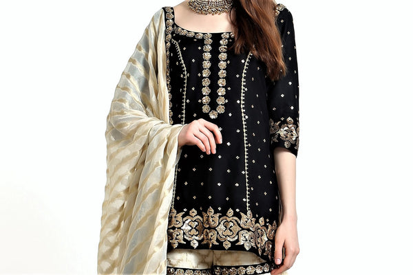 Buy black silk blend short kurta with ivory tissue net gharara online in USA. Get occasion ready with a stunning range of Indian designer suits from Pure Elegance fashion store in USA. We bring the best designer dresses for Indian women in USA at our online store. Shop now.-kurta