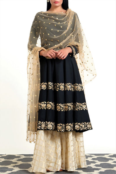 Buy black hand embroidered silk short kalidaar with palazzo online in USA. Get occasion ready with a stunning range of Indian designer suits from Pure Elegance fashion store in USA. We bring the best designer dresses for Indian women in USA at our online store. Shop now.-full view