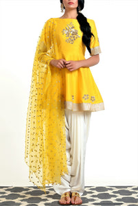 Buy yellow silk blend peplum kurta with white dhoti salwar and net dupatta online in USA. Get occasion ready with a stunning range of Indian designer suits from Pure Elegance fashion store in USA. We bring the best designer dresses for Indian women in USA at our online store. Shop now.-full view