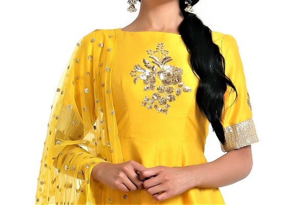 Buy yellow silk blend peplum kurta with white dhoti salwar and net dupatta online in USA. Get occasion ready with a stunning range of Indian designer suits from Pure Elegance fashion store in USA. We bring the best designer dresses for Indian women in USA at our online store. Shop now.-kurta
