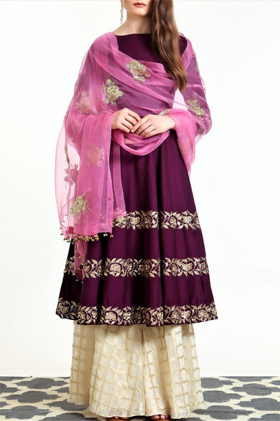 Buy jamni color hand embroidered silk blend short kalidaar with sharara online in USA. Get occasion ready with a stunning range of Indian designer suits from Pure Elegance fashion store in USA. We bring the best designer dresses for Indian women in USA at our online store. Shop now.-full view