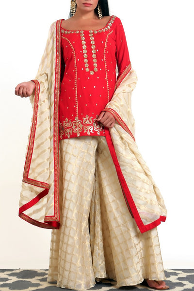 Buy crimson red silk blend short kurta with gold tissue net gharara online in USA. Get occasion ready with a stunning range of Indian designer suits from Pure Elegance fashion store in USA. We bring the best designer dresses for Indian women in USA at our online store. Shop now.-full view