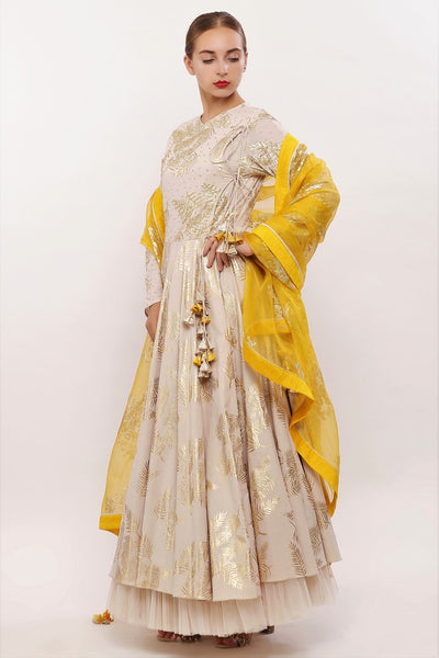 Buy beige cotton printed Angrakha suit with dupatta and churidaar online in USA. Pick your favorite Indian designer suits and dresses from Pure Elegance clothing store in USA. Ace your style game with a range of Indian saris, Anarkali suits, designer lehengas also available on our online store.  -side