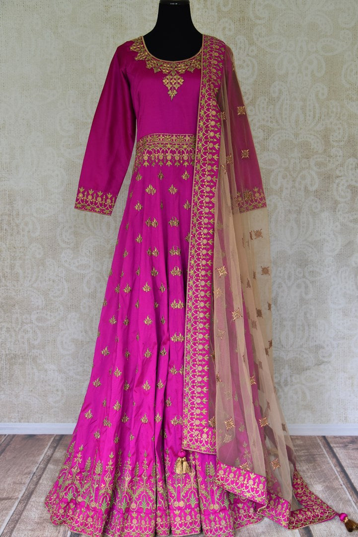 Buy magenta embroidered floor-length silk Anarkali suit online in USA. Elevate your ethnic style with a range of captivating Indian designer clothes from Pure Elegance Indian clothing store in USA. Make the festive season bright with beautiful pure silk saris, Banarasi sarees, designer suits from our online store.-full view