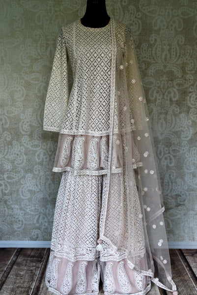 Shop white chikankari net suit with palazzo online in USA. Elevate your ethnic style with a range of captivating Indian designer clothes from Pure Elegance Indian clothing store in USA. Make the festive season bright with beautiful pure silk saris, Banarasi sarees, designer suits from our online store.-full view