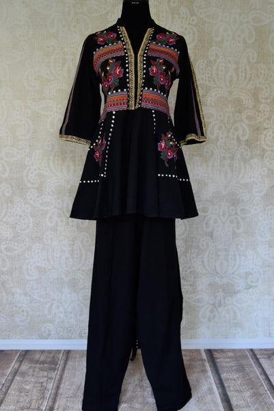Buy black embroidered linen tunic with palazzo online in USA. Elevate your ethnic style with a range of captivating Indian designer clothes from Pure Elegance Indian clothing store in USA. Make the festive season bright with beautiful pure silk saris, Banarasi saris, designer suits from our online store.-full view