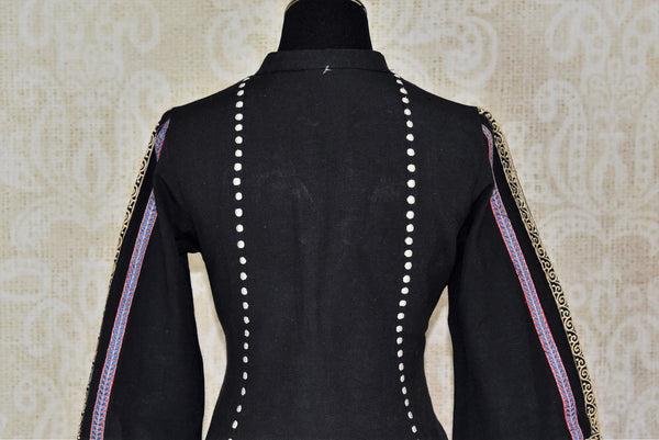 Buy black embroidered linen tunic with palazzo online in USA. Elevate your ethnic style with a range of captivating Indian designer clothes from Pure Elegance Indian clothing store in USA. Make the festive season bright with beautiful pure silk saris, Banarasi saris, designer suits from our online store.-back