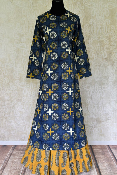 Buy blue Kalamkari print cotton kurta with yellow skirt online in USA. Elevate your ethnic style with a range of captivating Indian designer clothes from Pure Elegance Indian clothing store in USA. Make the festive season bright with beautiful pure silk saris, Banarasi saris, designer suits from our online store.-full view