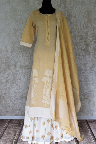 Shop cream gold embroidered kurta with skirt online in USA. Elevate your ethnic style with a range of captivating Indian designer clothing from Pure Elegance Indian clothing store in USA. Add designer suits, embroidered sarees, pure silk saris to your wardrobe for a beautiful look this festive season.-full view