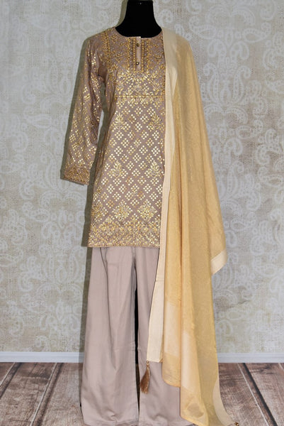 Buy beige color gota patti embroidery kurta with palazzo online in USA. Elevate your ethnic style with a range of captivating Indian designer clothing from Pure Elegance Indian clothing store in USA. Add designer suits, embroidered sarees, pure silk saris to your wardrobe for a beautiful look this festive season.-full view