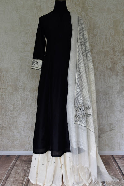 Shop black silk kurta with white palazzo and dupatta online in USA. Elevate your ethnic style with a range of captivating Indian designer clothes from Pure Elegance Indian clothing store in USA. Make the festive season bright with beautiful pure silk saris, Banarasi saris, designer suits from our online store.-full view