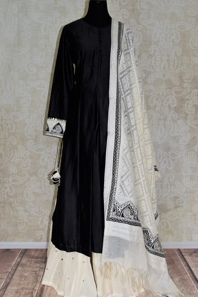 Buy black silk kurta with white palazzo online in USA and embroidered dupatta. Elevate your ethnic style with a range of captivating Indian designer clothes from Pure Elegance Indian clothing store in USA. Make the festive season bright with beautiful pure silk saris, Banarasi saris, designer suits from our online store.-full view