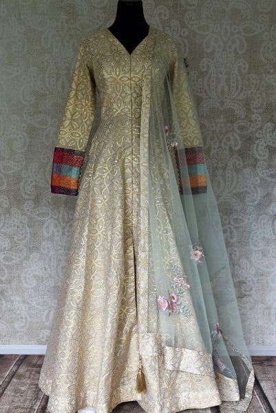 Buy beige color embroidered chanderi Anarkali with dupatta online in USA. Elevate your ethnic style with a range of captivating Indian designer clothing from Pure Elegance Indian clothing store in USA. Add designer suits, embroidered sarees, pure silk saris to your wardrobe for a beautiful look this festive season.-full view