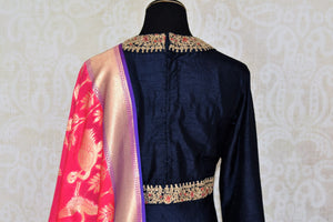 Buy navy blue embroidered floorlength Anarkali with pink dupatta online in USA from Pure Elegance. Add exquisite Indian designer suits, Indian dresses, wedding lehengas in beautiful styles and designs to your ethnic wardrobe from our Indian clothing store in USA or shop online.-back