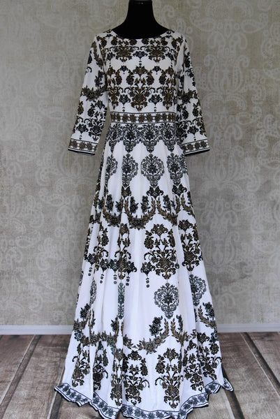 Buy ivory embroidered printed silk floorlength Anarkali suit with dupatta online in USA. Shop more such Indian designer Anarkali suits, designer Indian dresses, wedding dresses in USA from Pure Elegance clothing fashion store this wedding season.-full view
