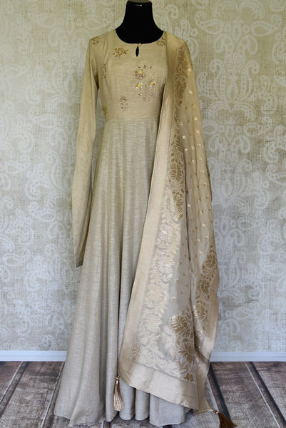 Shop stunning beige embroidered floorlength silk Anarkali suit with dupatta online in USA. Shop more such traditional Indian suits, designer wedding dresses, Anarkali suits in USA from Pure Elegance clothing fashion store this wedding season.-full view