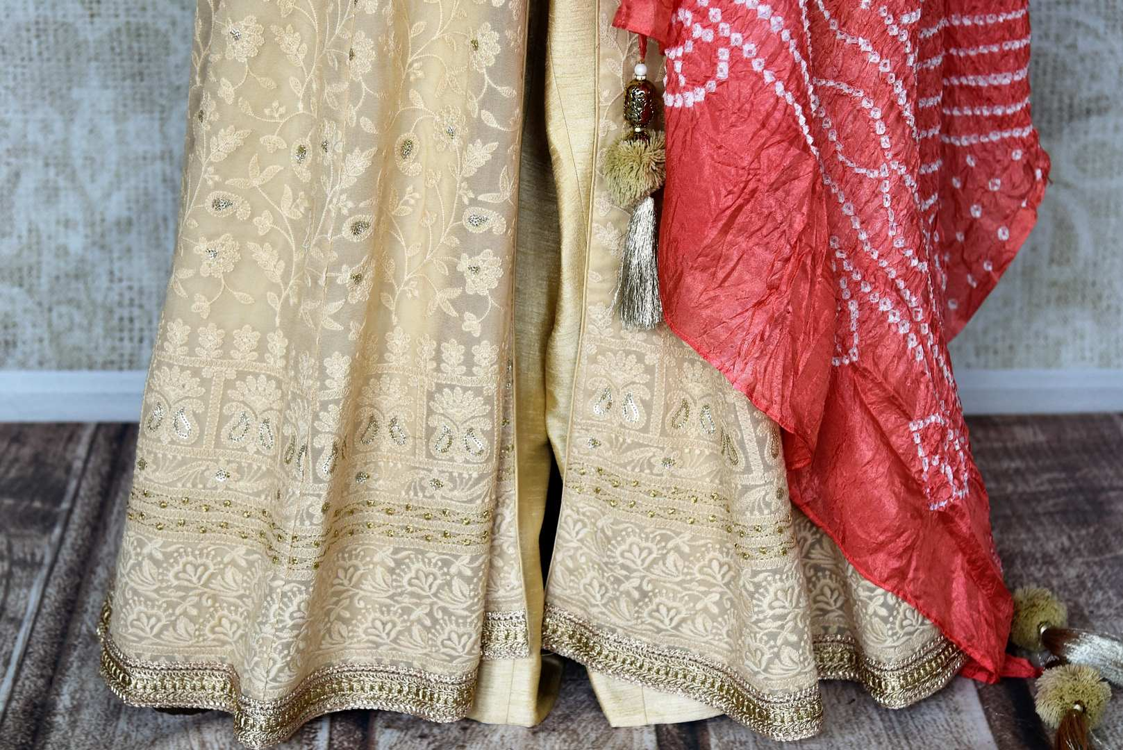 Buy beige embroidered georgette sharara online in USA with palazzo and dupatta from Pure Elegance. Add exquisite Indian designer suits, Indian dresses, wedding lehengas in beautiful styles and designs to your ethnic wardrobe from our Indian clothing store in USA or shop online.-bottom
