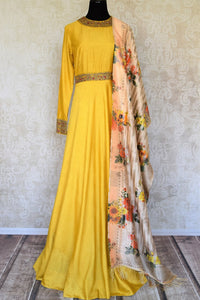 Shop yellow embroidered silk floor length Anarkali suit online in USA with printed dupatta from Pure Elegance. Choose from a range of exclusive Indian designer suits, wedding dresses, Anarkali suits in beautiful styles and designs from our Indian fashion store in USA and flaunt your tasteful sartorial choices on special occasions.-full view