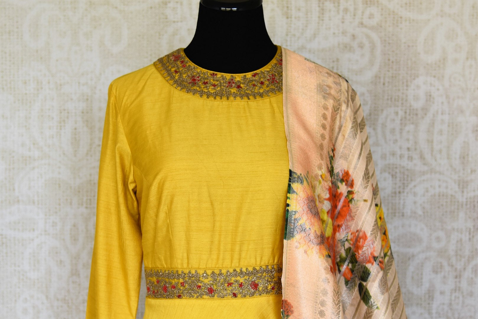 Shop yellow embroidered silk floor length Anarkali suit online in USA with printed dupatta from Pure Elegance. Choose from a range of exclusive Indian designer suits, wedding dresses, Anarkali suits in beautiful styles and designs from our Indian fashion store in USA and flaunt your tasteful sartorial choices on special occasions.-front