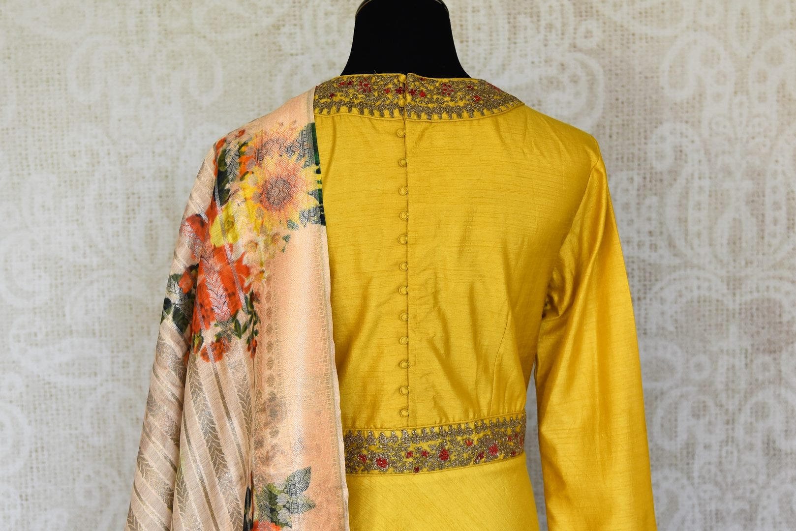 Shop yellow embroidered silk floor length Anarkali suit online in USA with printed dupatta from Pure Elegance. Choose from a range of exclusive Indian designer suits, wedding dresses, Anarkali suits in beautiful styles and designs from our Indian fashion store in USA and flaunt your tasteful sartorial choices on special occasions.-back