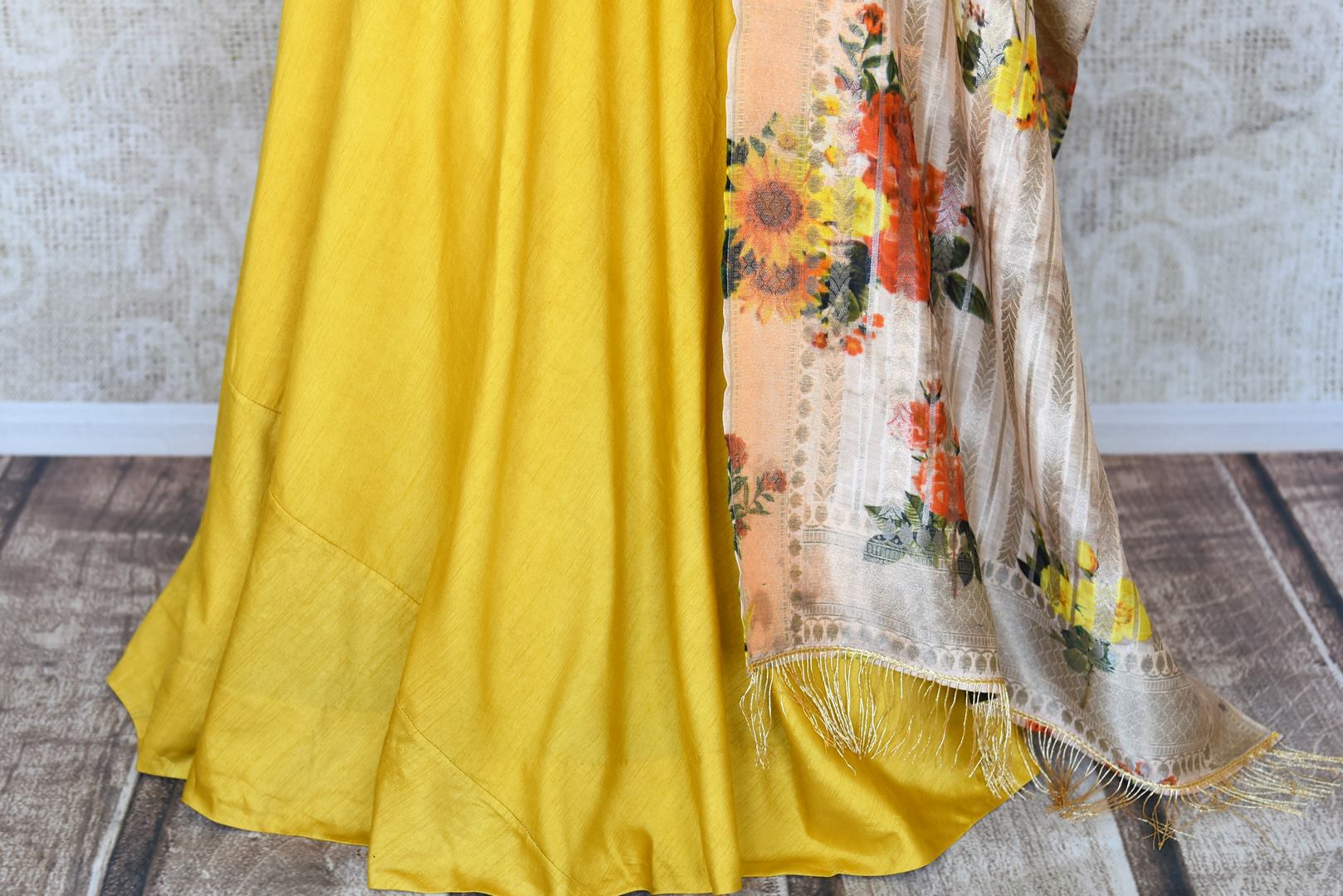Shop yellow embroidered silk floor length Anarkali suit online in USA with printed dupatta from Pure Elegance. Choose from a range of exclusive Indian designer suits, wedding dresses, Anarkali suits in beautiful styles and designs from our Indian fashion store in USA and flaunt your tasteful sartorial choices on special occasions.-bottom