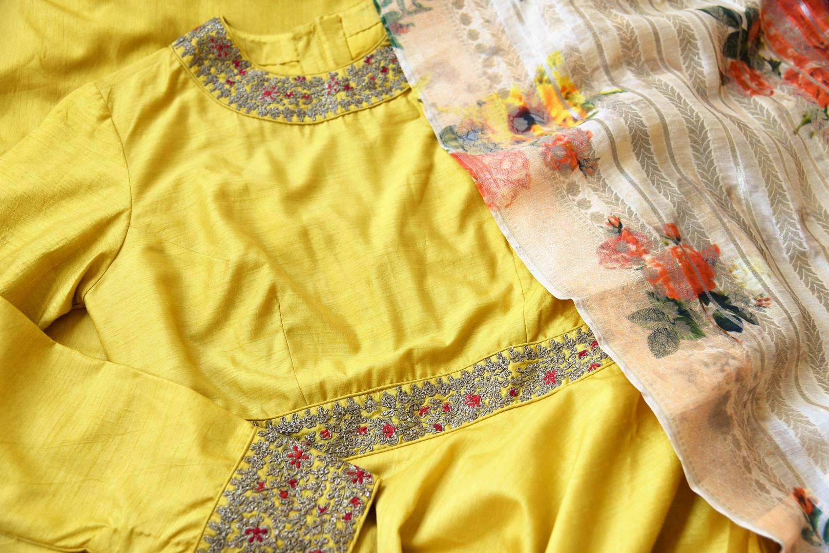 Shop yellow embroidered silk floor length Anarkali suit online in USA with printed dupatta from Pure Elegance. Choose from a range of exclusive Indian designer suits, wedding dresses, Anarkali suits in beautiful styles and designs from our Indian fashion store in USA and flaunt your tasteful sartorial choices on special occasions.-details