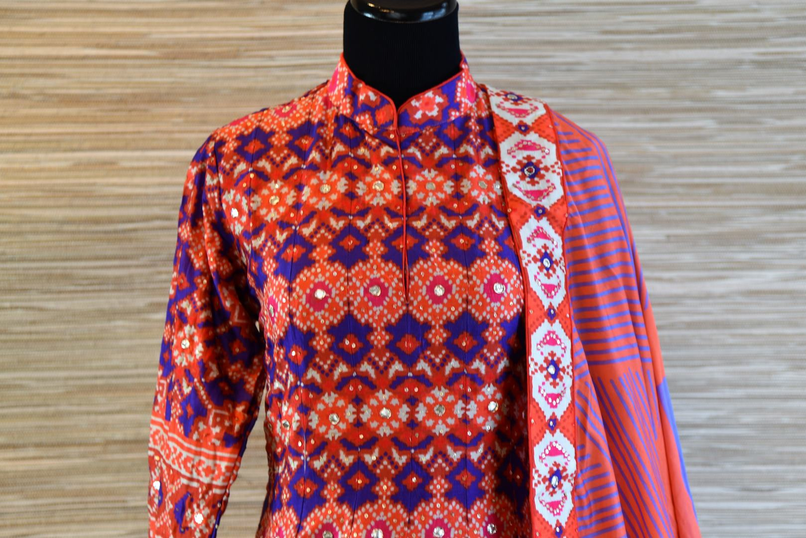 Buy orange and blue chanderi silk patola print floor length Anarkali suit online in USA. Be the talk of every occasion with exquisite Indian designer suits from Pure Elegance Indian clothing store in USA. -front