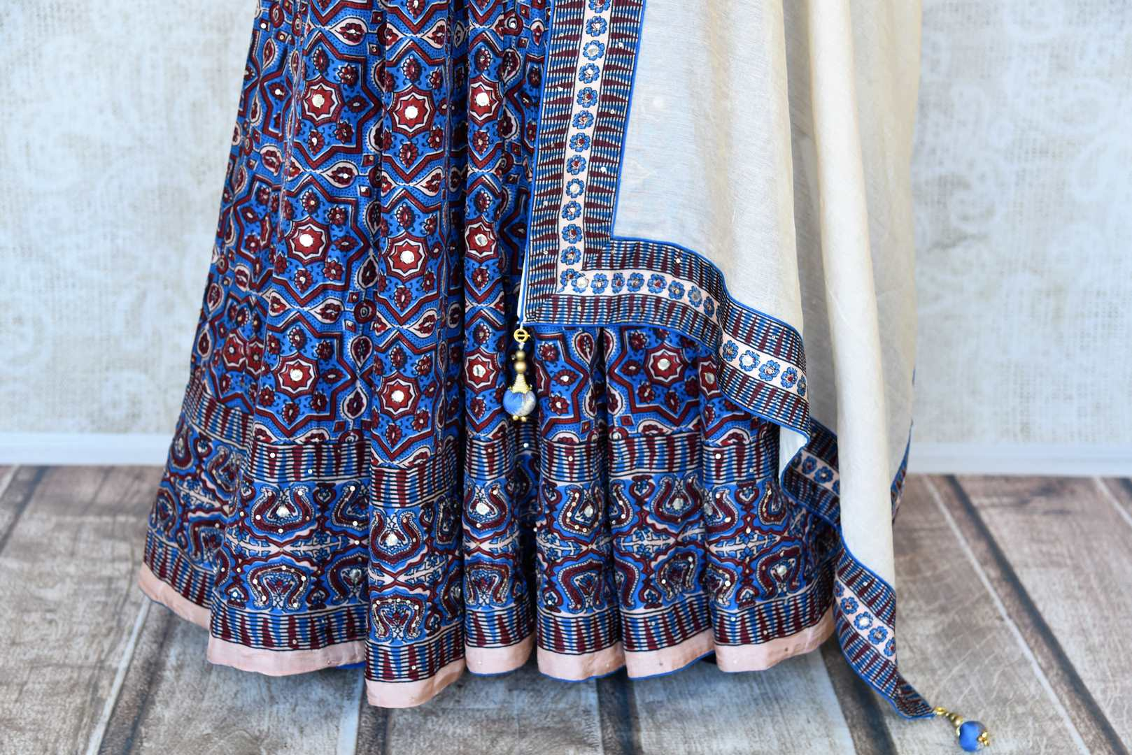 Buy blue Kalamkari print silk Anarkali suit online in USA with gota work. Make your party style absolutely special with beautiful Indian designer suits from Pure Elegance Indian fashion store in USA. Get floored with a range of beautiful Anarkali suits, designer lehengas, Indian dresses all under one roof for Indian women in USA.-bottom