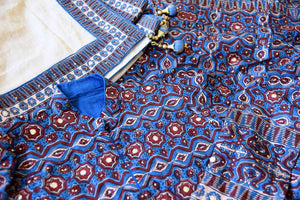 Buy blue Kalamkari print silk Anarkali suit online in USA with gota work. Make your party style absolutely special with beautiful Indian designer suits from Pure Elegance Indian fashion store in USA. Get floored with a range of beautiful Anarkali suits, designer lehengas, Indian dresses all under one roof for Indian women in USA.-details