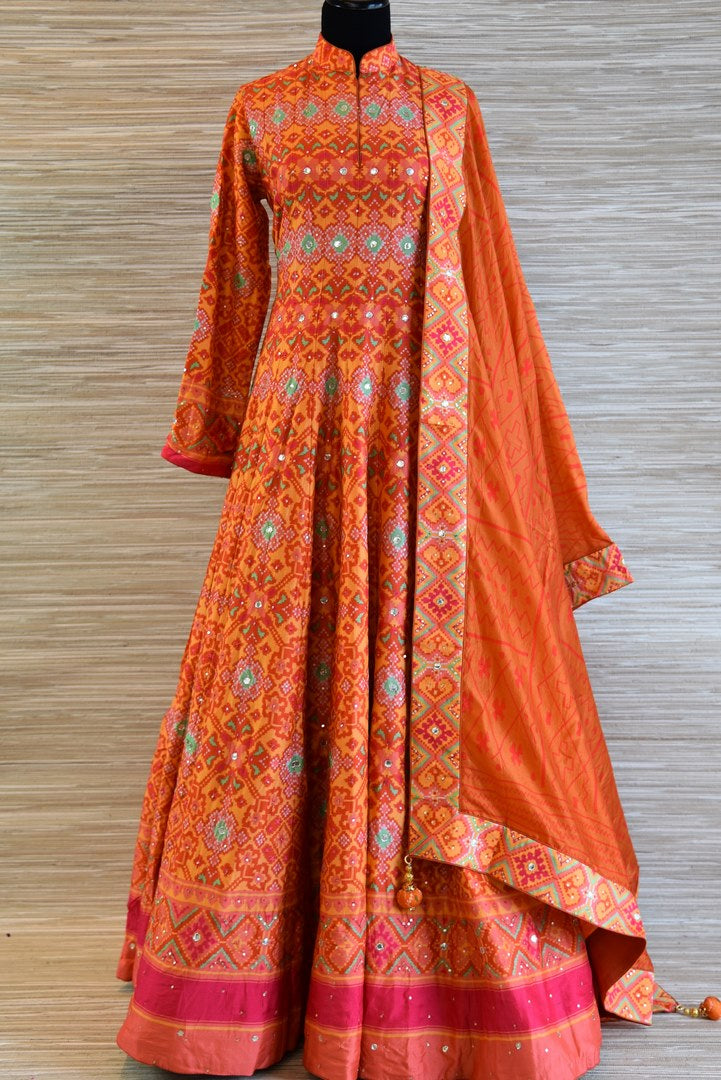 Shop bright orange chanderi silk patola print Anarkali suit online in USA with dupatta. Be the talk of every occasion with exquisite Indian designer suits from Pure Elegance Indian clothing store in USA. -full view