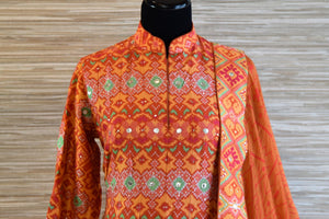Shop bright orange chanderi silk patola print Anarkali suit online in USA with dupatta. Be the talk of every occasion with exquisite Indian designer suits from Pure Elegance Indian clothing store in USA. -front