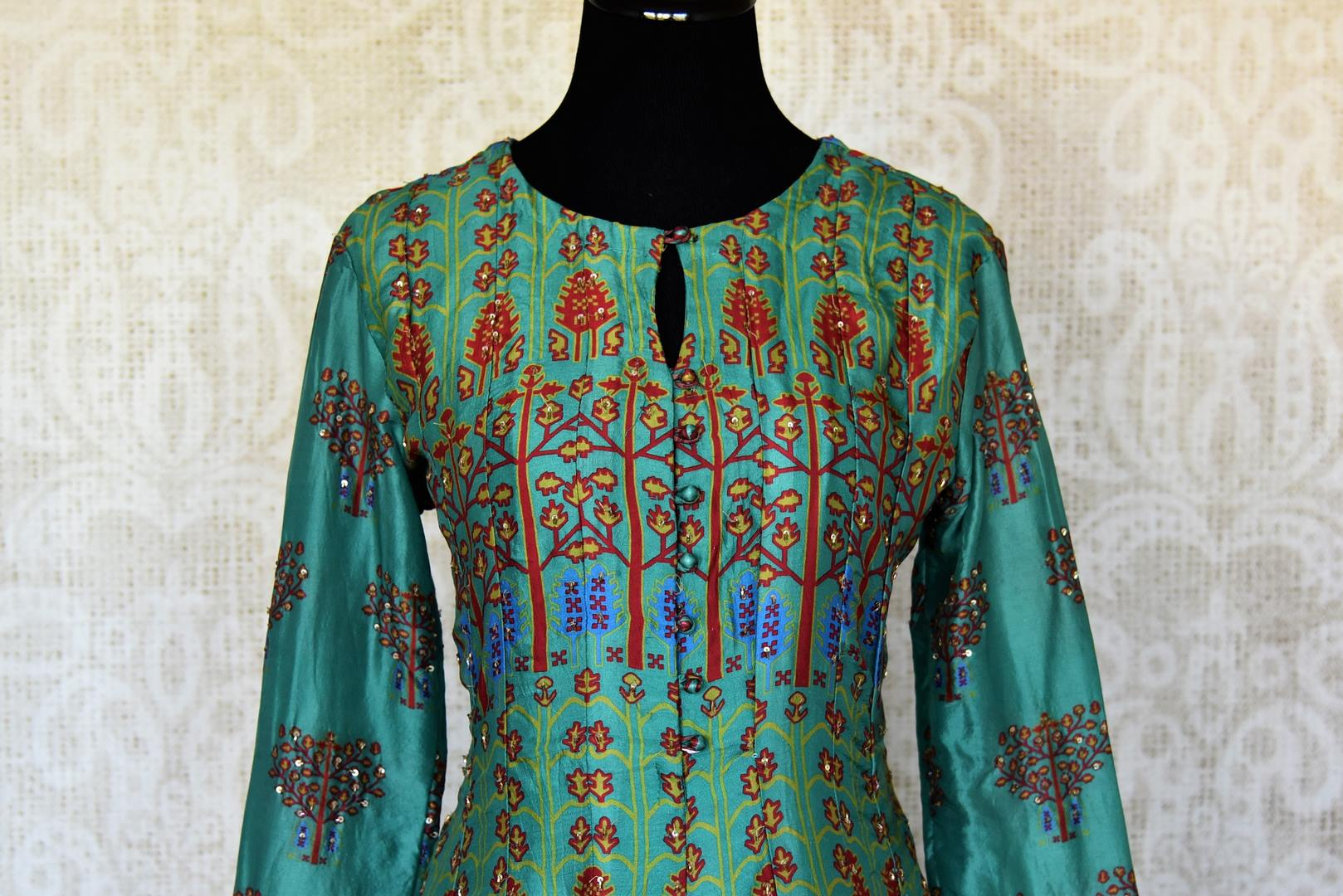 Buy green printed crepe silk Anarkali dress online in USA with handwork. Make your party style absolutely special with beautiful Indian designer suits from Pure Elegance Indian fashion store in USA. Get floored with a range of beautiful Anarkali suits, designer lehengas, Indian dresses all under one roof for Indian women in USA.-front