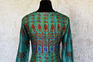 Buy green printed crepe silk Anarkali dress online in USA with handwork. Make your party style absolutely special with beautiful Indian designer suits from Pure Elegance Indian fashion store in USA. Get floored with a range of beautiful Anarkali suits, designer lehengas, Indian dresses all under one roof for Indian women in USA.-back