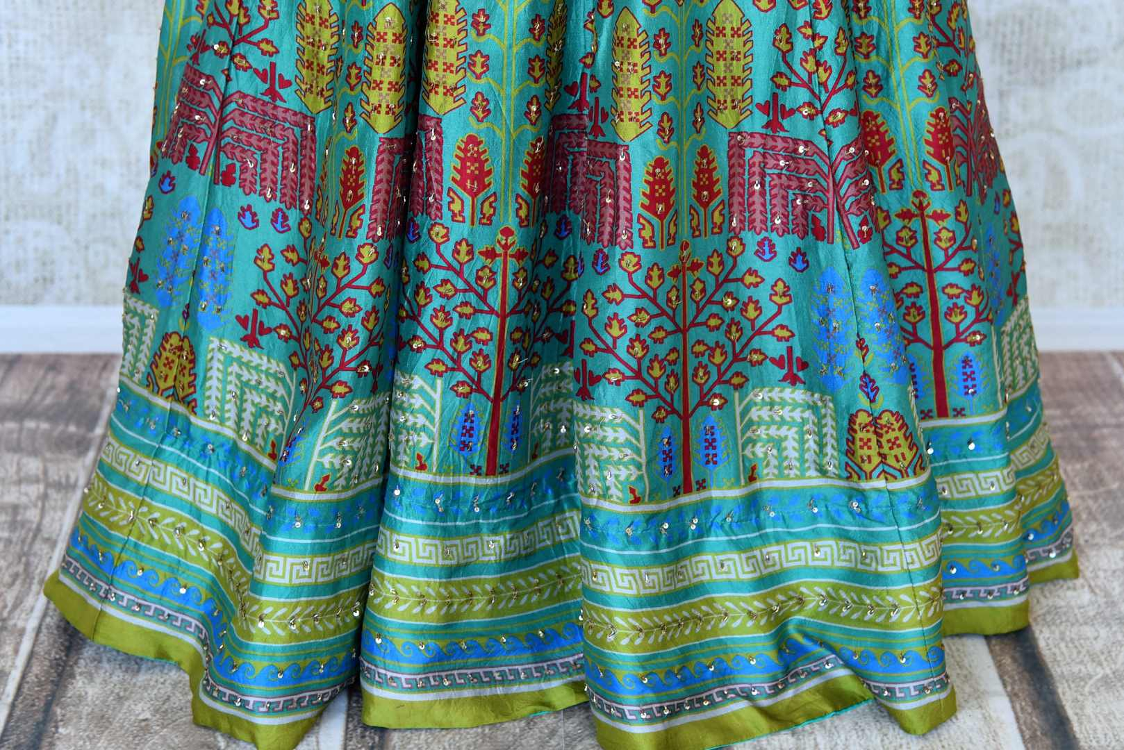 Buy green printed crepe silk Anarkali dress online in USA with handwork. Make your party style absolutely special with beautiful Indian designer suits from Pure Elegance Indian fashion store in USA. Get floored with a range of beautiful Anarkali suits, designer lehengas, Indian dresses all under one roof for Indian women in USA.-bottom