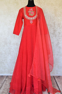 Shop red silk georgette embroidered Anarkali suit online in USA. Be the talk of weddings and special occasions with a splendid collection of Indian designer suits from Pure Elegance Indian clothing store in USA. We have a spectacular range of designer dresses, designer lehengas for Indian women in USA.-full view