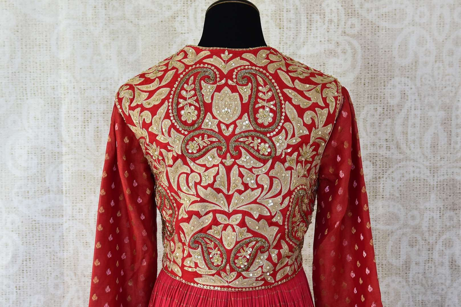 Red embroidered chanderi silk floorlength Anarkali for online shopping in USA. Get floored by a vibrant collection of Indian clothing at Pure Elegance Indian fashion store in USA. Choose from a beautiful range of Indian designer suits, Anarkalis, designer lehengas for weddings and special occasions.-back