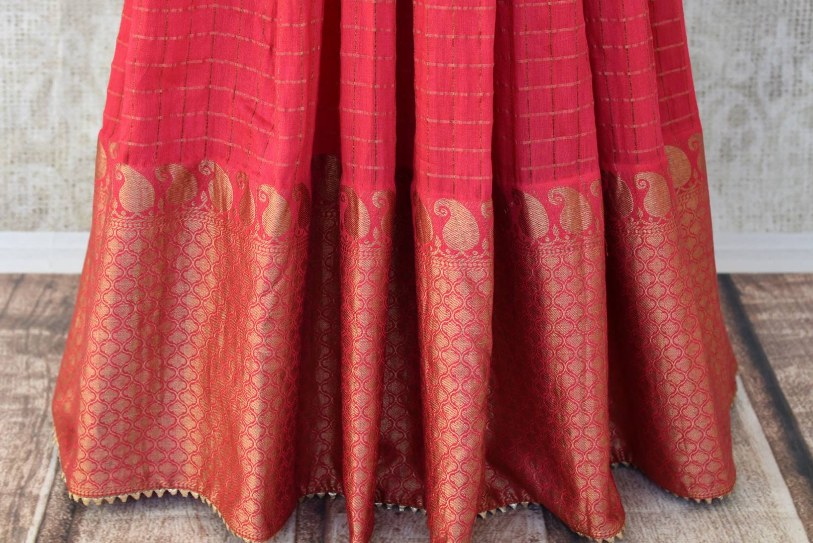 Red embroidered chanderi silk floorlength Anarkali for online shopping in USA. Get floored by a vibrant collection of Indian clothing at Pure Elegance Indian fashion store in USA. Choose from a beautiful range of Indian designer suits, Anarkalis, designer lehengas for weddings and special occasions.-bottom