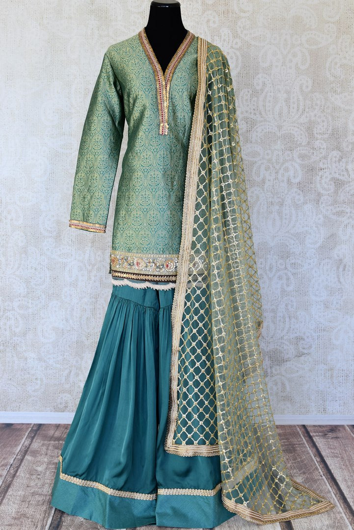 Buy green embroidered Banarasi silk sharara suit online in USA with dupatta. Keep your wardrobe update with latest Indian clothing from Pure Elegance Indian fashion store in USA. Shop beautiful Indian designer lehengas, Anarkali suits, gowns for Indian women in USA from our online store.-full view