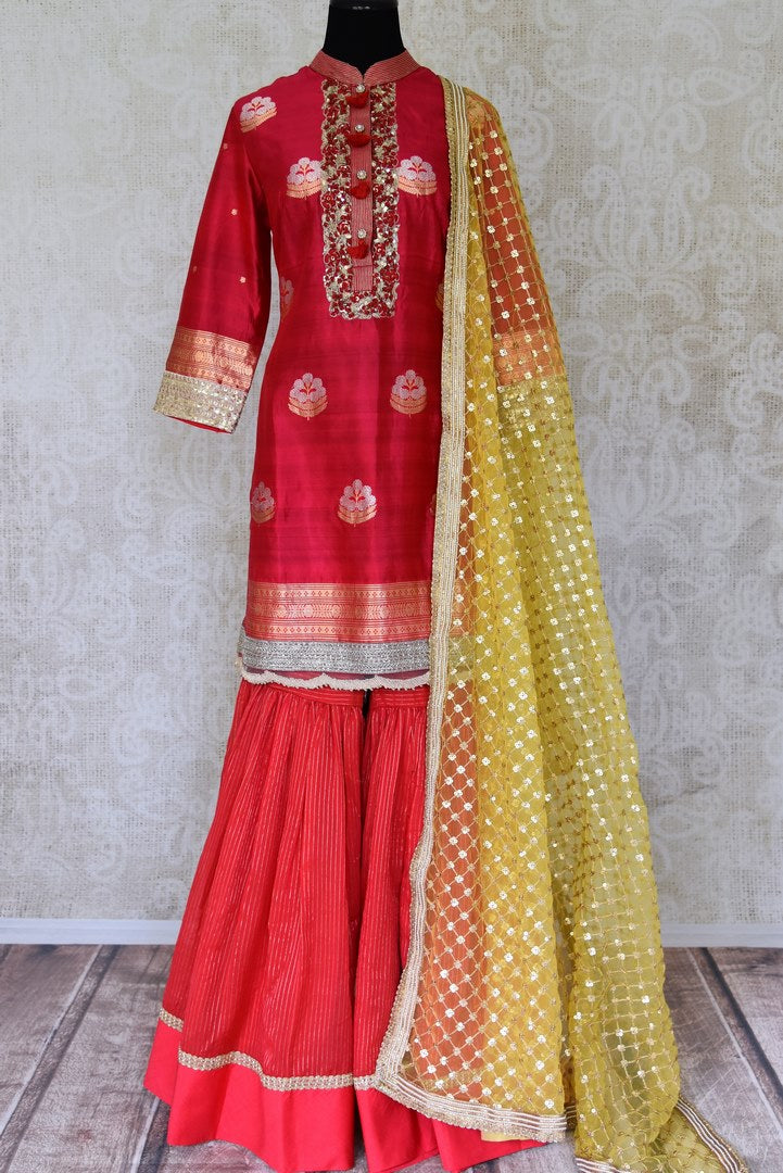 Buy beautiful red hand embroidered silk sharara suit online in USA with yellow dupatta. Shine bright on weddings and special occasions with beautiful Indian designer suits, Anarkali suits, designer lehengas from Pure Elegance Indian fashion store in USA.-full view