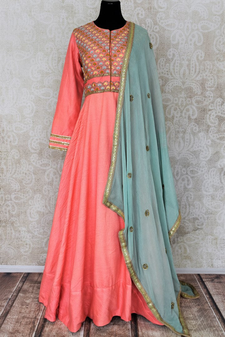 Peach hand embroidered silk Anarkali for online shopping in USA with blue dupatta. Get floored by a vibrant collection of Indian designer clothes at Pure Elegance Indian fashion store in USA. Choose from a beautiful range of Indian wedding dresses, designer lehengas and suits for special occasions.-full view