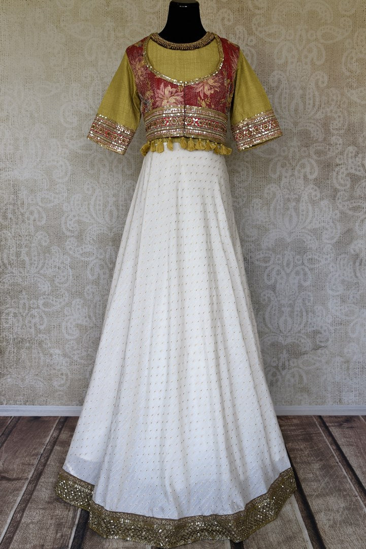 Shop white and green hand embroidery silk Anarkali dress online in USA. Raise your ethnic style quotient at special occasions with exquisite Indian clothing from Pure Elegance Indian clothing store in USA. Pick from a tasteful collection of designer lehengas, Anarkali suits, Indian dresses. Shop now.-full view