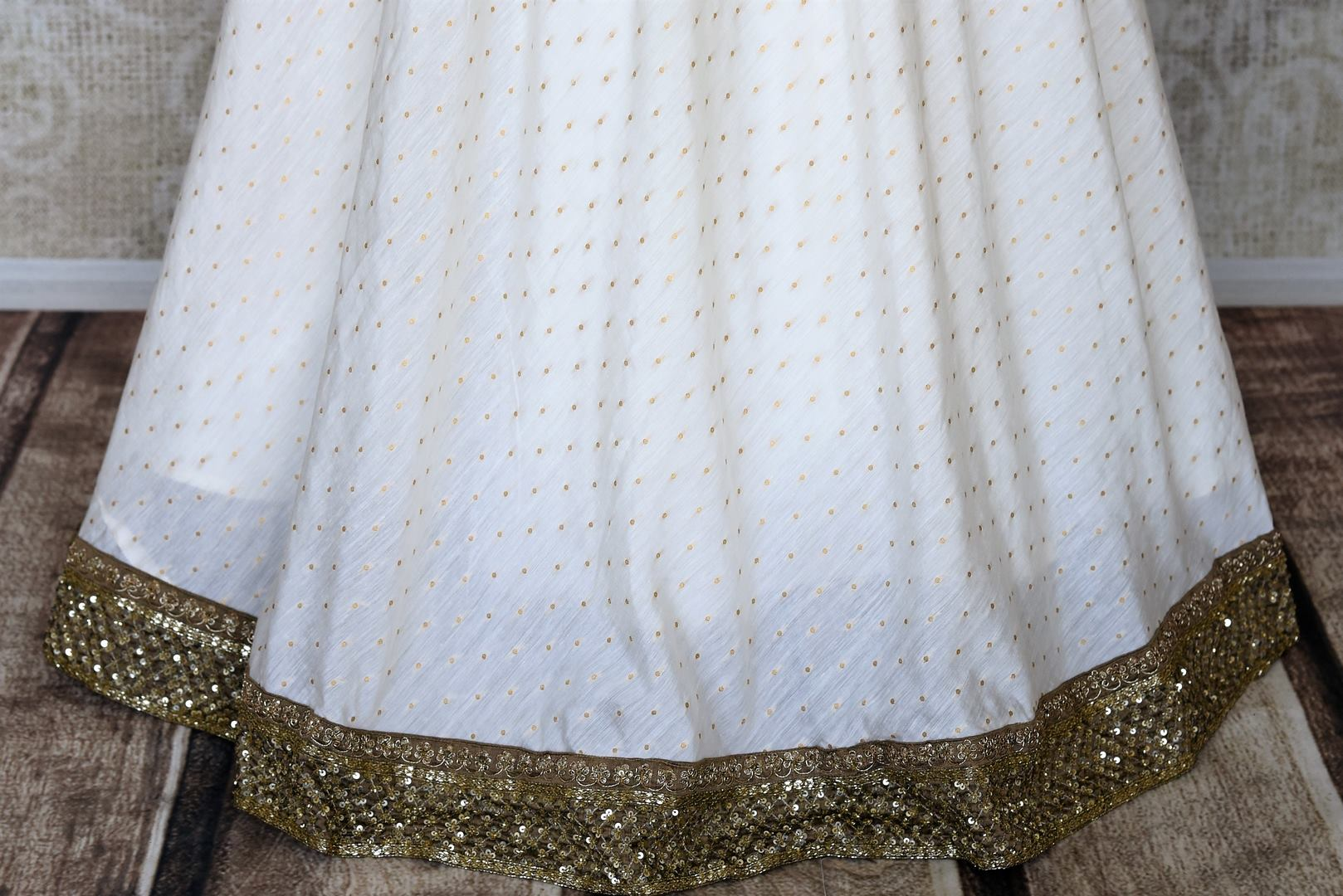 Shop white and green hand embroidery silk Anarkali dress online in USA. Raise your ethnic style quotient at special occasions with exquisite Indian clothing from Pure Elegance Indian clothing store in USA. Pick from a tasteful collection of designer lehengas, Anarkali suits, Indian dresses. Shop now.-bottom