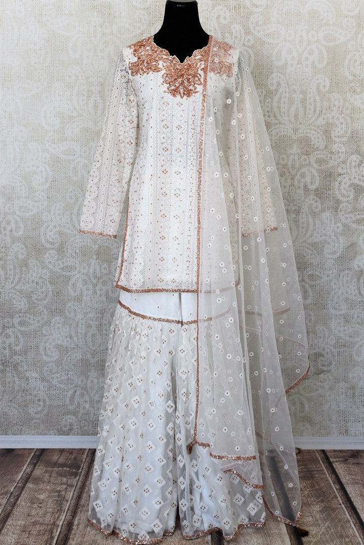 White embroidered net suit with palazzo for online shopping in USA. Get floored by a vibrant collection of Indian clothing at Pure Elegance Indian fashion store in USA. Choose from a beautiful range of Indian designer suits, Anarkalis, designer lehengas for weddings and special occasions.-full view