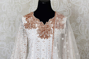 White embroidered net suit with palazzo for online shopping in USA. Get floored by a vibrant collection of Indian clothing at Pure Elegance Indian fashion store in USA. Choose from a beautiful range of Indian designer suits, Anarkalis, designer lehengas for weddings and special occasions.-front
